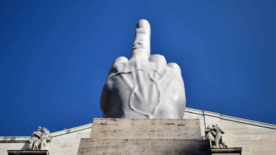 "A sculpture officially titled ""L.O.V.E."" but popularly known as ""The Middle Finger"" - by Italian artist Maurizio Cattelan."