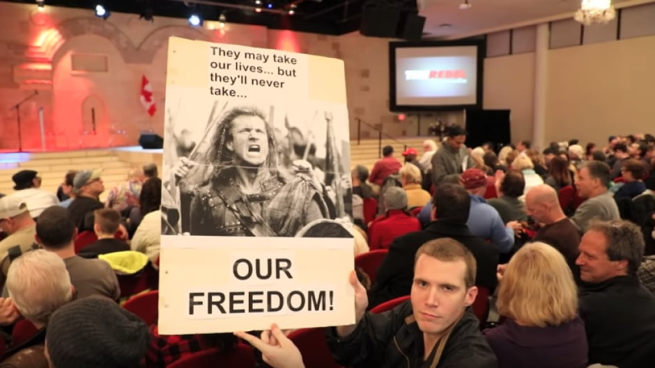 An attendee holds a homemade sign at the Rebel Media Freedom Rally in Toronto on February 15, 2017.