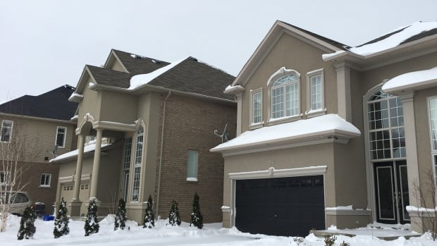 Neighbours said Karim Baratov lived alone in a three-bedroom house on Chambers Drive in Ancaster.