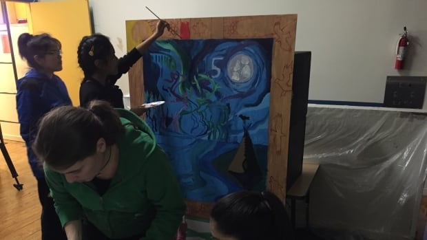 Students from Mildred Hall School in Yellowknife work on a mural for Canada's 150th birthday celebrations.