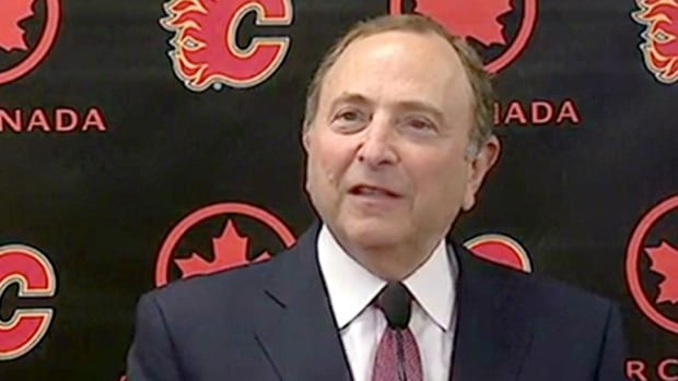NHL commissioner Gary Bettman speaks to reporters in Calgary.