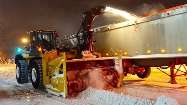 Snow-removal crews were out on the streets early Thursday.