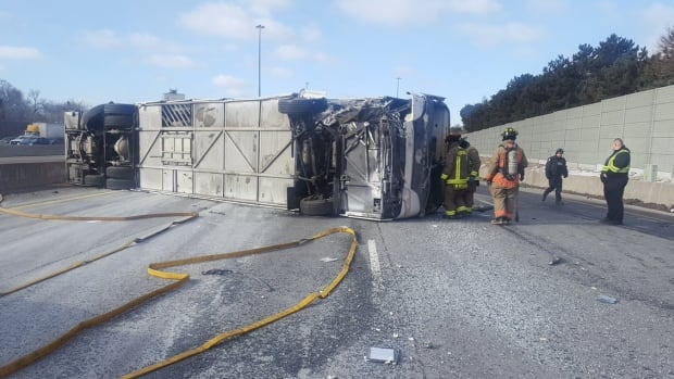 Police say it appears the bus driver lost control, hit a median, and rolled over on the 401.