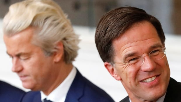 Dutch Prime Minister Mark Rutte, right, of the VVD Liberal party and Dutch far-right politician Geert Wilders of the PVV Party take part in a meeting at the Dutch Parliament Thursday after the general election.
