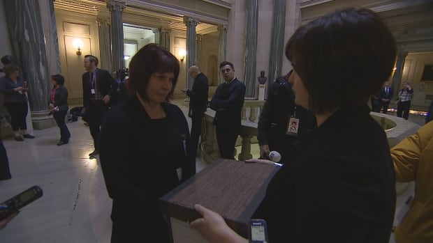 Jackie Christianson delivers a box full of letters which detail the concern regarding funding cuts and education funding in Saskatchewan.