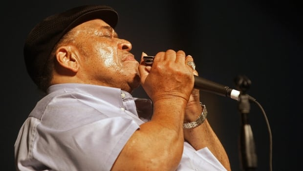 James Cotton performs during the 2008 New Orleans Jazz & Heritage Festival in New Orleans Saturday, April 26, 2008. (AP Photo/Dave Martin)