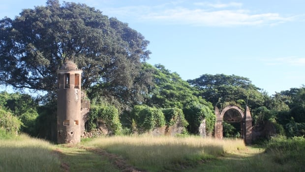 The watchtower and gate to the slave barracks on the former Angerona Coffee Plantation in Havana Province, Cuba.
