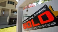 Vancouver housing real estate sold sign