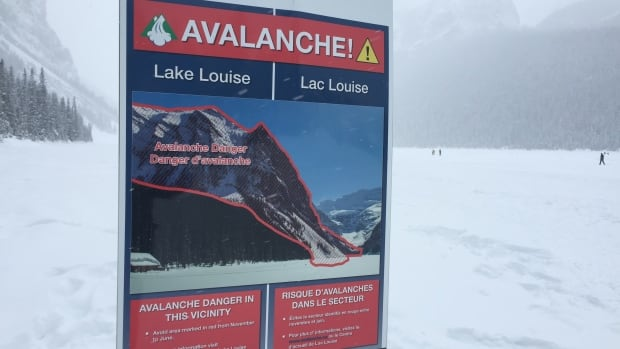 A sign at Lake Louise in Banff National Park warns visitors of overhead avalanche danger ahead.