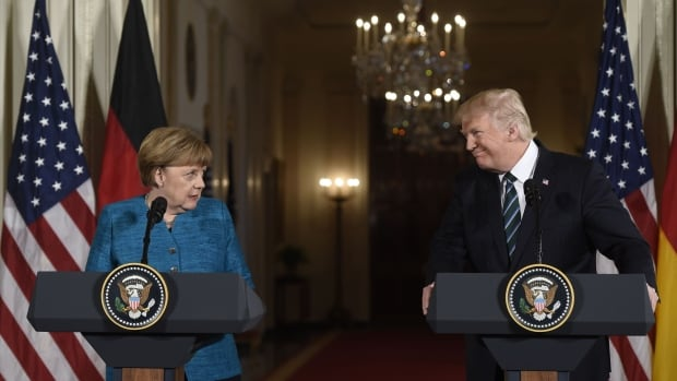 U.S. President Donald Trump and German Chancellor Angela Merkel hold a joint news conference in the East Room of the White House in Washington on Friday.