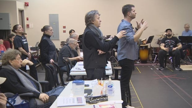 Garth Drabinsky, far left, sits behind director Adrian Noble, centre, during one of the rehearsals of the new musical Sousatzka.