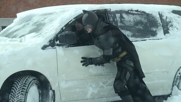 Mehdi Bennani Smires has been the co-owner of MJ Anim'Action for six years and Thursday decided to suit up as Batman to help people struggling in the snow.
