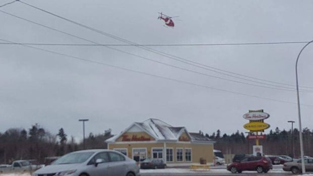 A Coast Guard helicopter flies over the Tim Hortons in O'Leary last week.