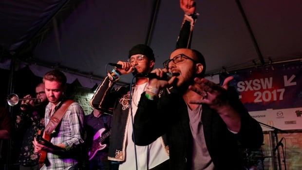 Kayem (C), who is Libyan-American, performs with Bassel and the Supernaturals at the ContraBanned showcase featuring artists representing countries included in U.S. President Donald Trump's executive order travel bans, at the South by Southwest music festival Saturday.