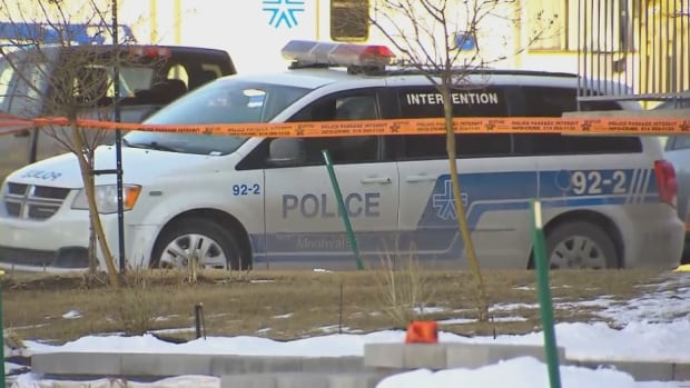 Police investigate the scene in Anjou after a body was found lifeless on Saturday morning.