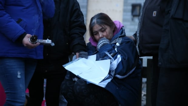 Lana Fontaine sat on a stool outside her largely burned-down home on Saturday evening at a vigil for her daughter, Jeanenne Fontaine, who died on Wednesday after being taken off life-support.