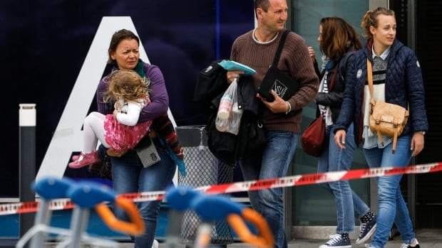 Travellers evacuate Orly airport on Saturday after a man tackled a soldier guarding the southern terminal.