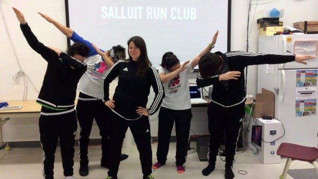 Maggie MacDonnell, seen here with the running club she founded in Salluit, Que, has has won the $1 Million US Global Teaching Prize for her work.