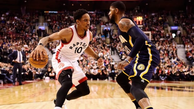 Toronto Raptors guard DeMar DeRozan (10) tries to get past Indiana Pacers forward Paul George (13) during the first half.