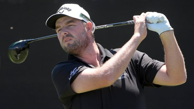 Marc Leishman, of Australia, watches his tee shot on the first hole during the final round of the Arnold Palmer Invitational golf tournament.
