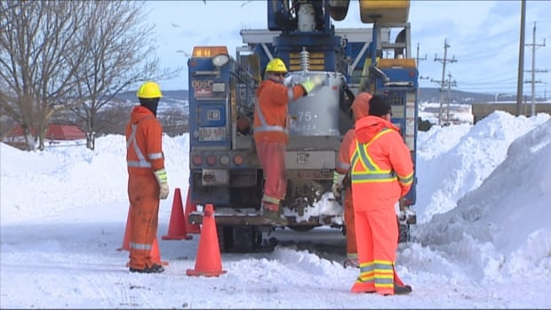 Newfoundland Power workers are called out to make repairs in weather that keeps most people indoors.