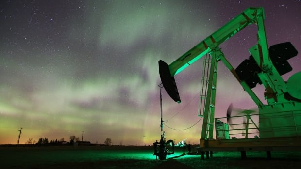 A rebound in oil prices at the start the year has boosted business confidence in 2017, says ATB Financial. In the photo, a pumpjack operates beneath the aurora borealis northwest of Calgary.