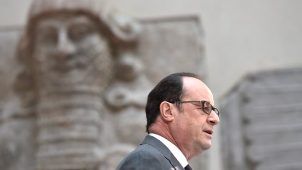 French President François Hollande delivers a speech at the Louvre in Paris on Monday. France is trying to raise tens of millions of dollars from international donors to protect cultural heritage sites threatened by war and the kind of destruction carried out by Islamic State militants.
