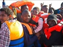 Migrants and refugees are rescued from a crowded wooden boat north of Sabratha, Libya, on February 18, 2017.