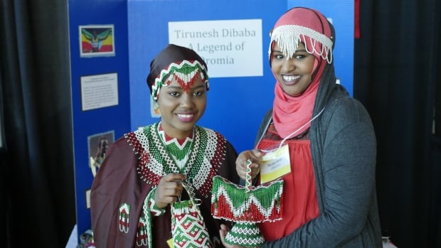 Young students like Ethiopia's Ayan Kadir (left) and Naima Ayub, gathered at The Rooms on Sunday to highlight their culture.
