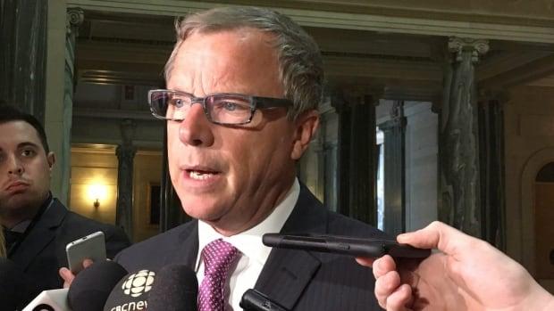 Saskatchewan Premier Brad Wall talks to members of the media in Regina.