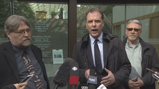 David Fai (left) and Paul Doroshenko (centre) in front of B.C. Supreme Court in March 2017 where they filed a lawsuit against the B.C. Liberals over its advertisements leading up to the election.