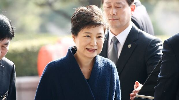Park Geun-hye, recently impeached as president, arrives at the entrance of the Seoul Central District Prosecutors' Office to undergo questioning on Tuesday.