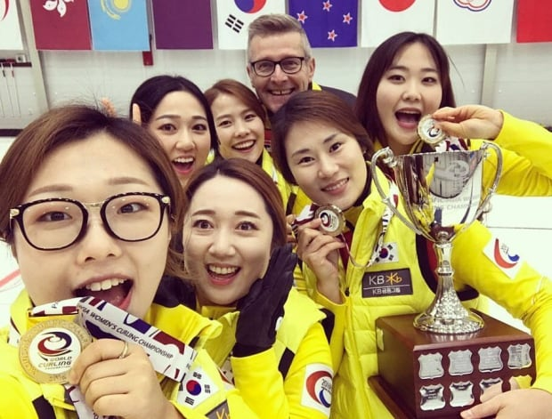 Peter Gallant of P.E.I. with his South Korea women's curling team