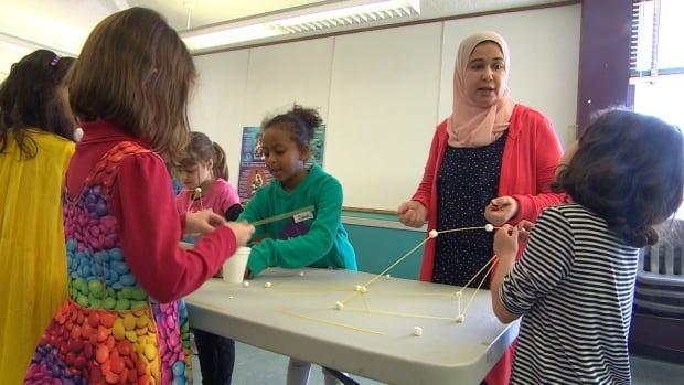 Students from Al-Hijra Islamic School work with students from Winnipeg Mennonite Elementary School to build towers out of spaghetti and marshmallows.
