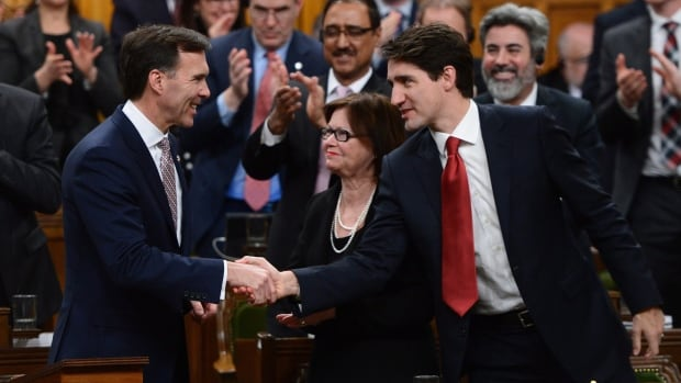 Prime Minister Justin Trudeau, right, shakes hands with Finance Minister Bill Morneau after he delivered the federal budget in the House of Commons Wednesday.