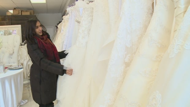 Reeshma Ramnarine searches in vain for her wedding dress on the racks at Marsha Clyne Wedding and Event Design on Lake Shore Boulevard West.