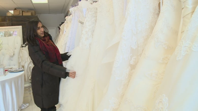 b2cd8941df7e Reeshma Ramnarine searches in vain for her wedding dress on the racks at  Marsha Clyne Wedding and Event Design on Lake Shore Boulevard West. (CBC  News)