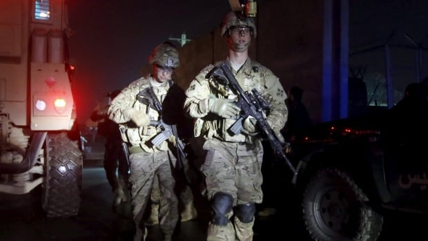 U.S. troops arrive at the site of an explosion in Kabul on Jan. 4, 2016.