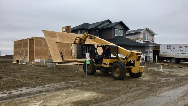 Framing crews work on a new home in Saskatoon's new Brighton neighbourhood.