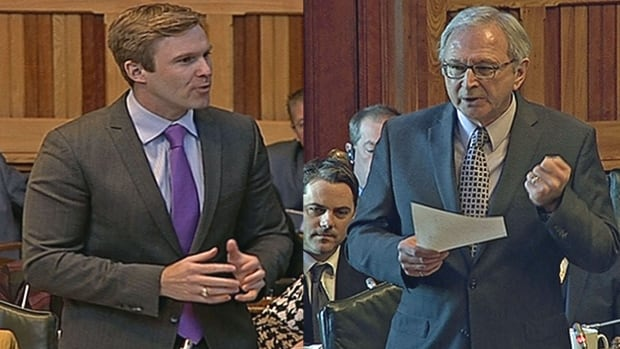 Opposition Leader Blaine Higgs, right, spent much of Question Period asking Premier Brian Gallant if the province had signed the contract with Medavie to run the extramural program.