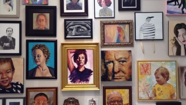 Portraits adorn the walls at cSPACE, the new arts centre in the historic King Edward School in South Calgary.