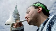A man smoking a joint at a pro-pot rally in Ottawa in 2014