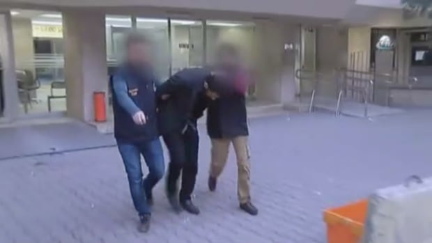 In this screen grab taken from a video, Wassim Boughadou is seen being arrested in Adana, Turkey, earlier this month.