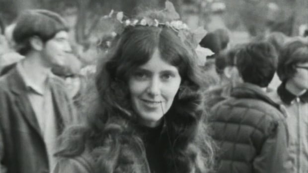 A young woman stands among the crowd at the 1967 Vancouver 'Be In' that was modelled after a similar event two months prior in San Francisco.