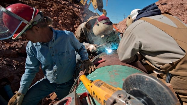 Welder Brent Mauldin, centre, works on construction of the Gulf Coast Project pipeline in Prague, Oklahoma, in this file photo from March 11, 2013. The Gulf Coast Project is part of the Keystone Pipeline Project.