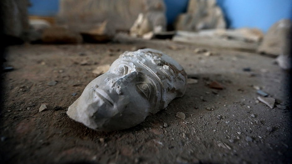 The face of a statue lies on the ground at the destroyed museum in the ancient Syrian city of Palmyra last year.  Jihadists view the UNESCO-listed site's magnificent ruins as idolatrous.