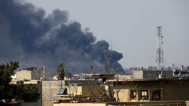 Smoke rises from from the old city of Mosul during a battle against ISIS militants on Friday.