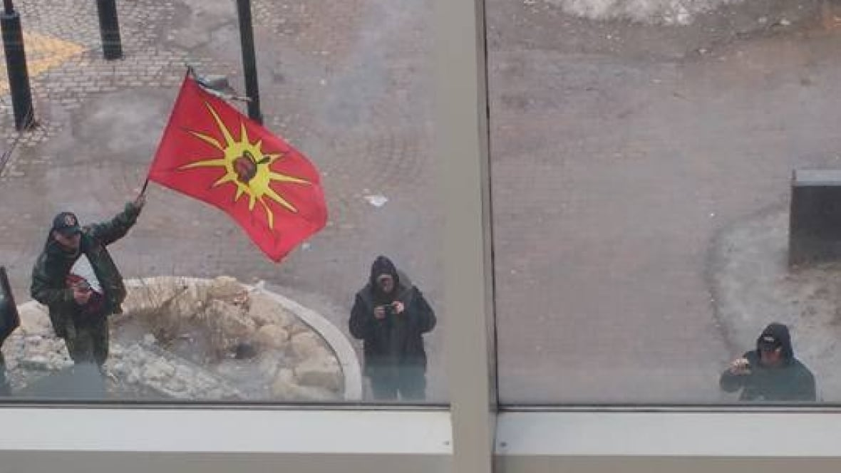 Indigenous activists confronting drug dealers at Portage Place