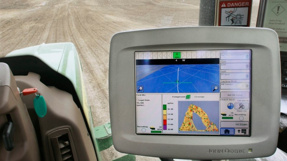 Inside the cabin of a GPS-equipped John Deere tractor.