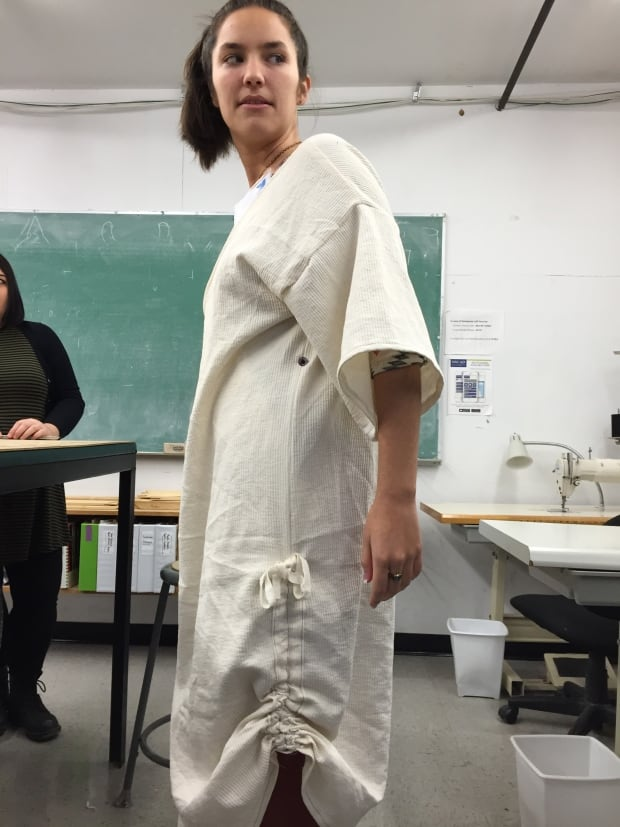 Model tries on hospital gown prototуpe